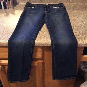 three pairs of jeans